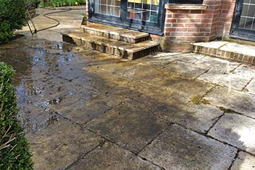 Before Pressure Tech cleaned the patio in Ightham